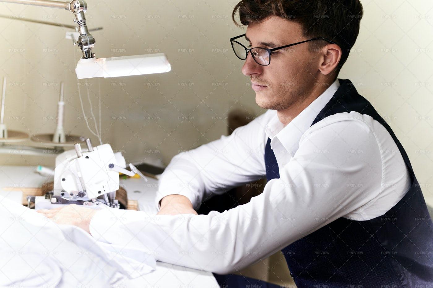 Young Tailor At Serger Machine: Stock Photos