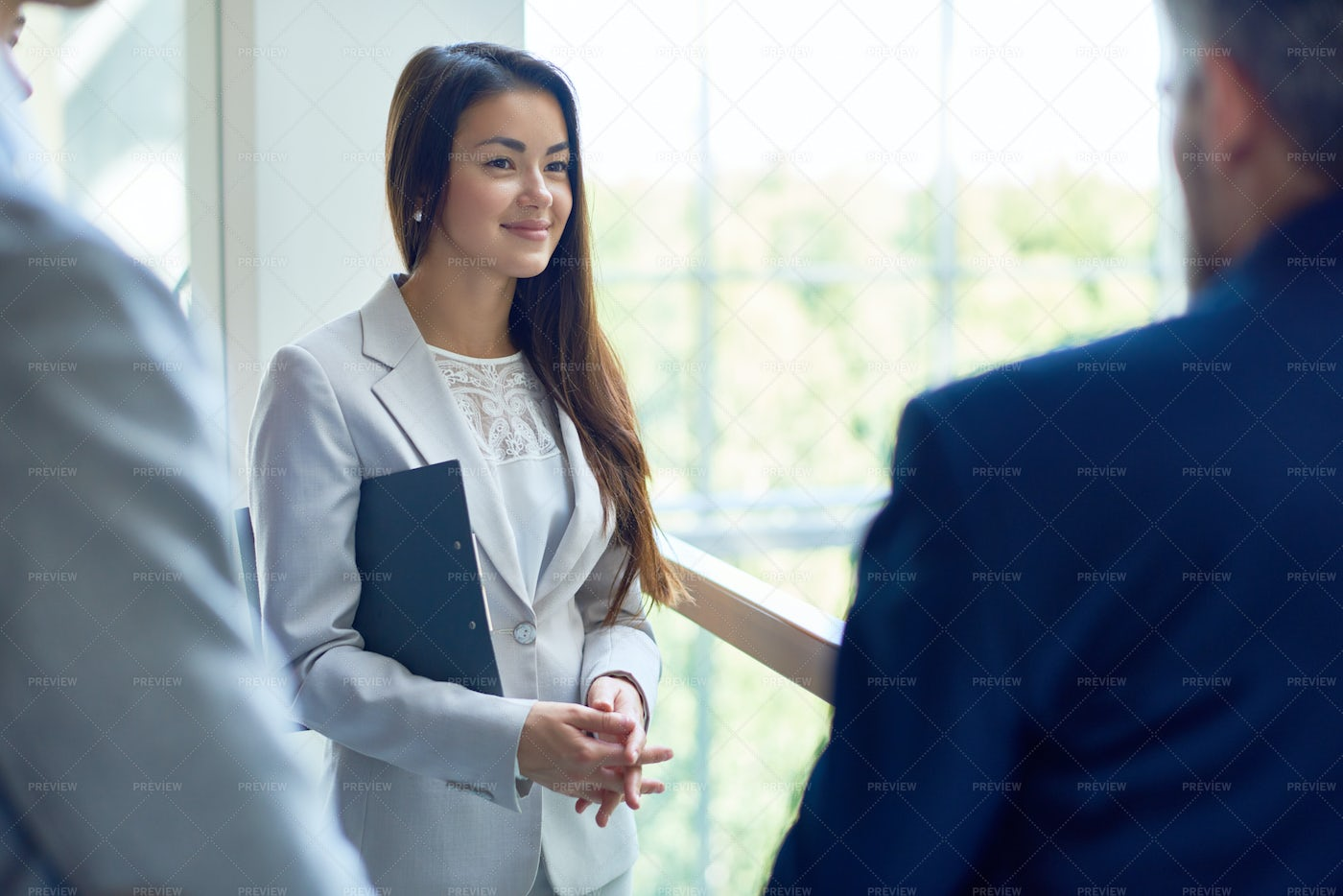 Young Business Woman Talking With...: Stock Photos