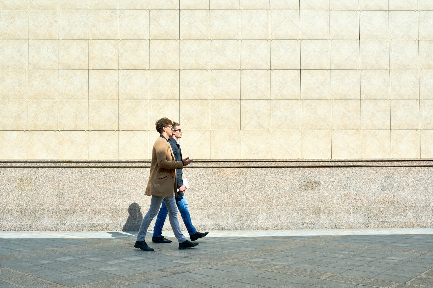 Modern Businessmen Walking In City: Stock Photos