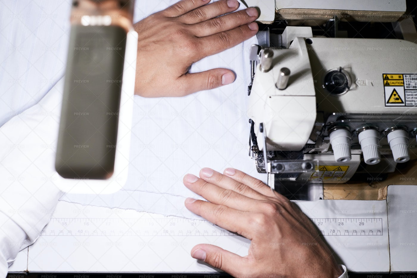 Tailor Sewing Clothes Close Up: Stock Photos
