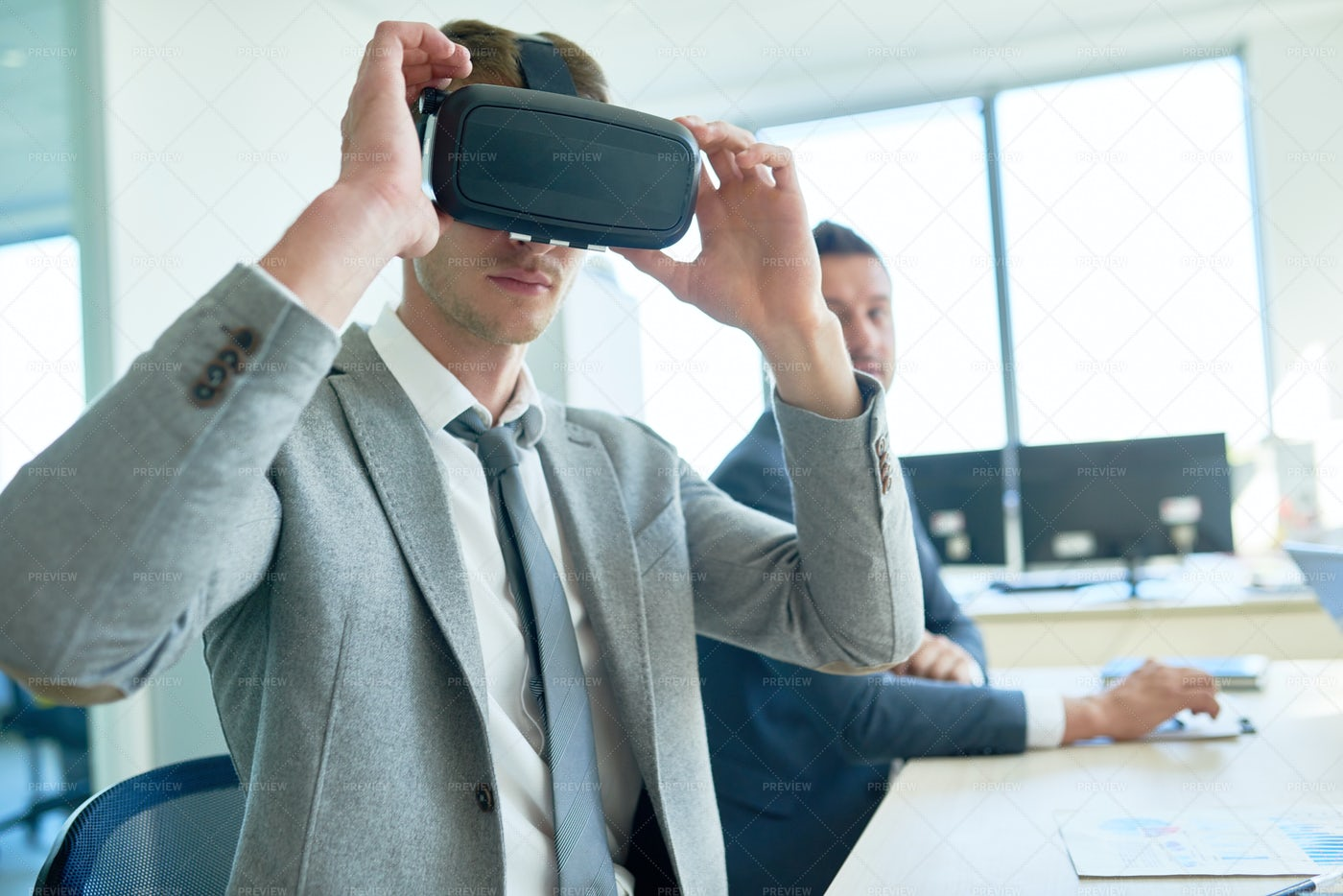 Handsome Businessman Using VR...: Stock Photos