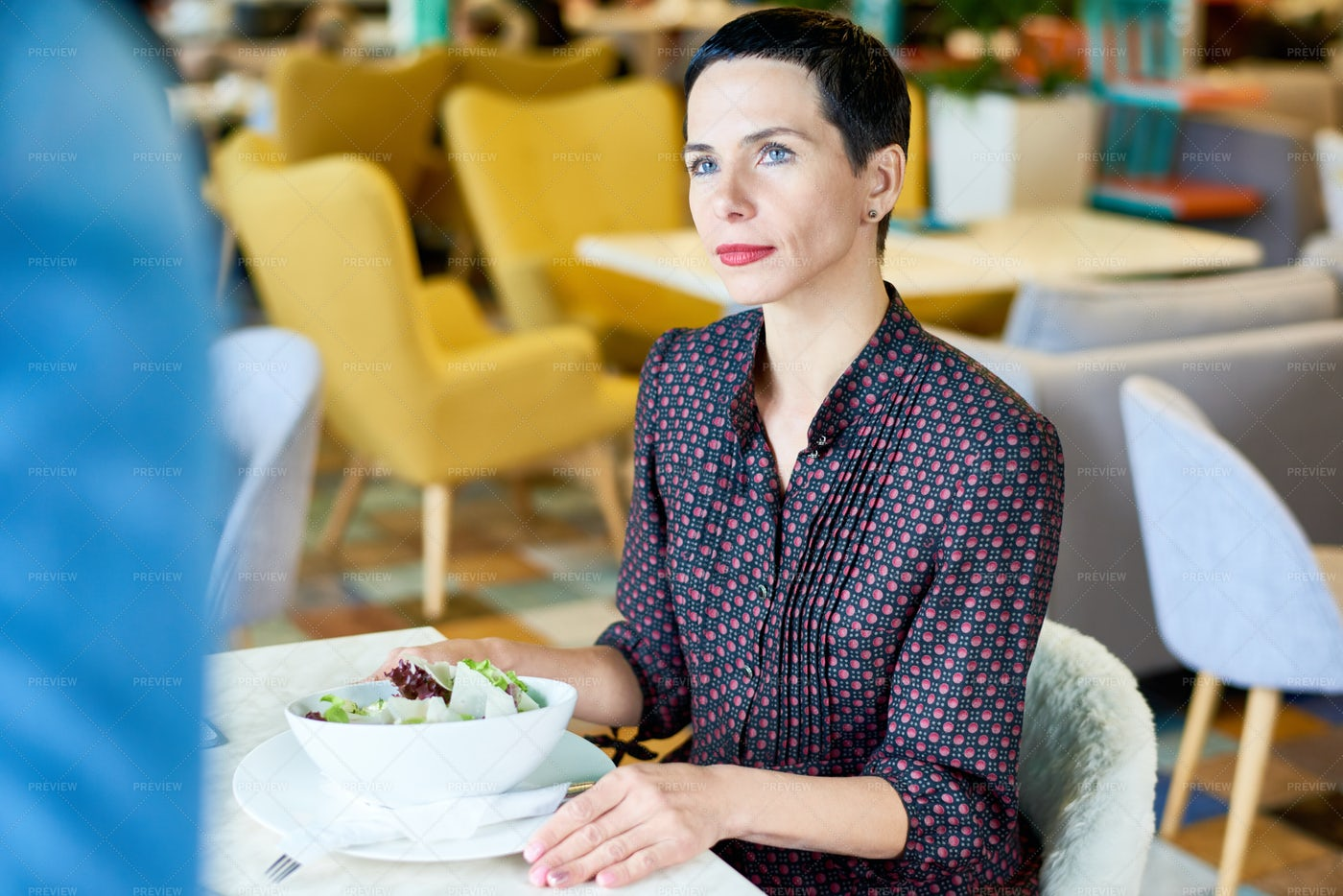 Elegant Woman At Cafe Table: Stock Photos