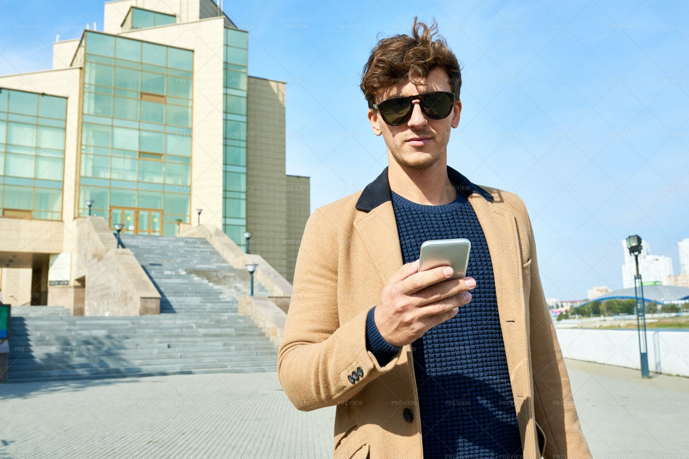 Handsome Young Man With Smartphone...: Stock Photos