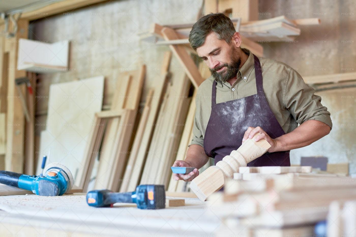 Bearded Carpenter Carving Stair...: Stock Photos