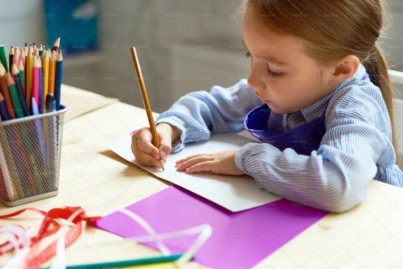 Cute Girl Drawing In Art Class: Stock Photos