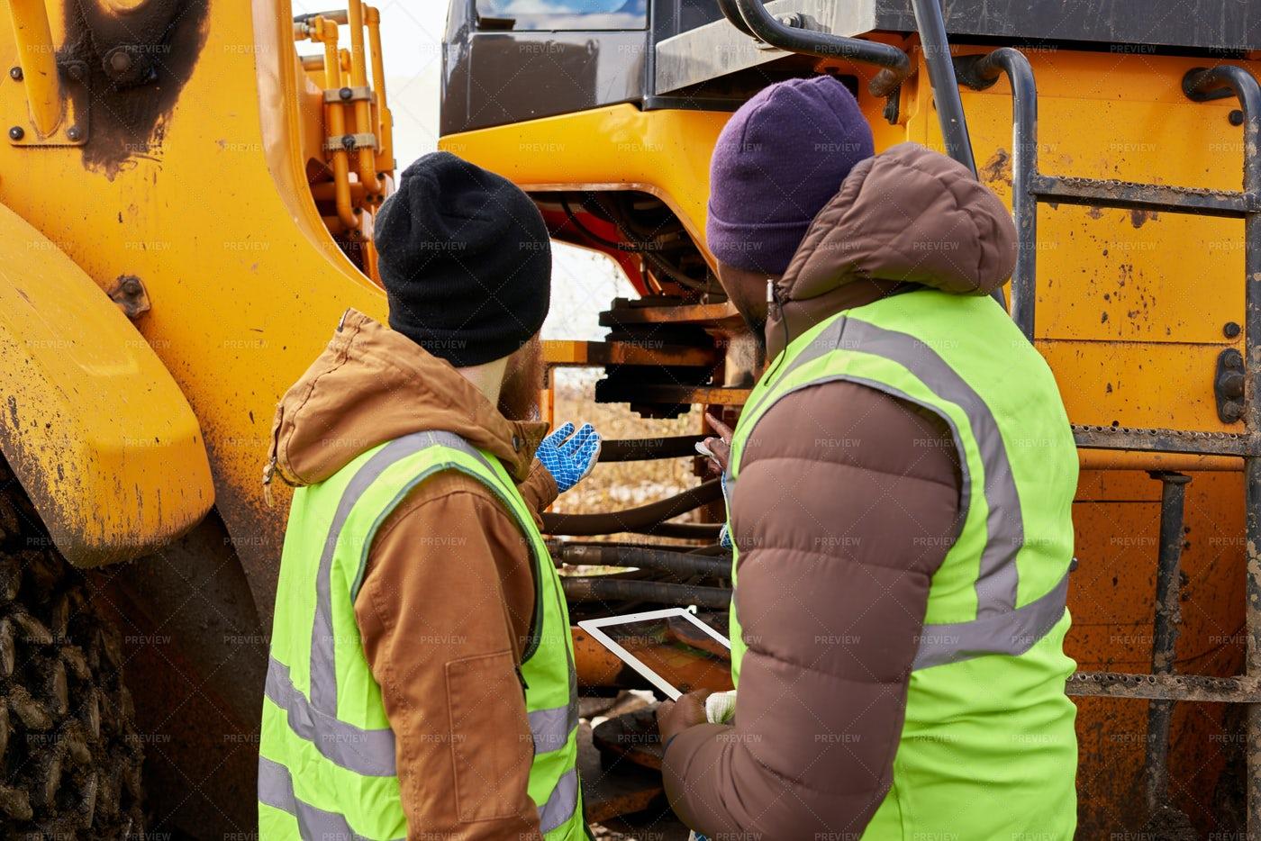 Mechanics Inspecting Truck Outdoors: Stock Photos