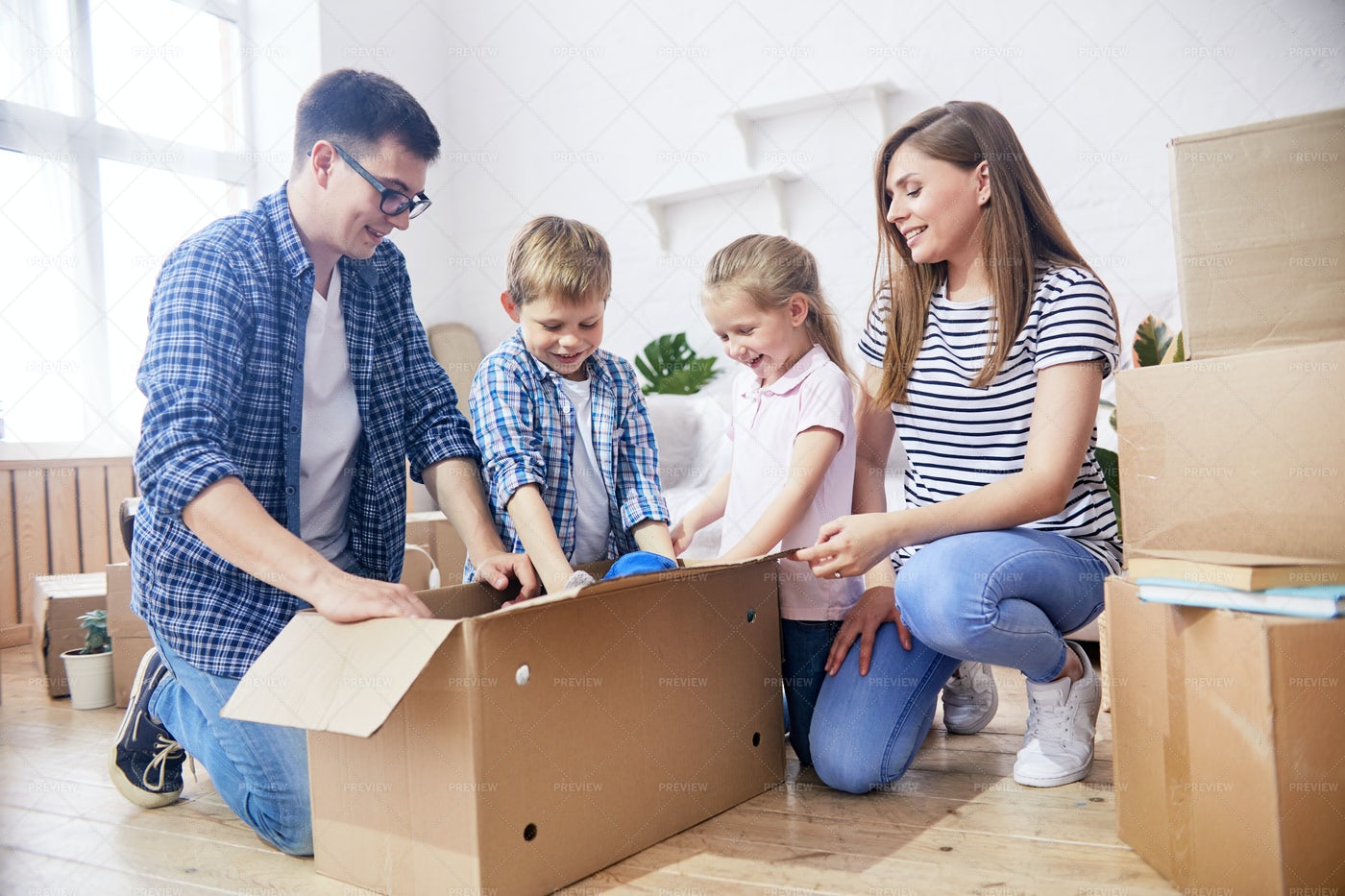 Unpacking Moving Boxes...: Stock Photos