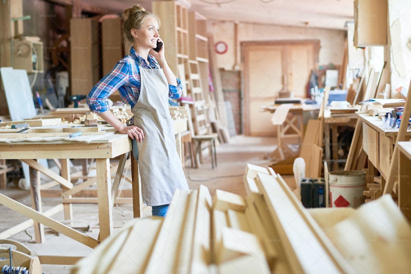 Female Carpenter Speaking By...: Stock Photos