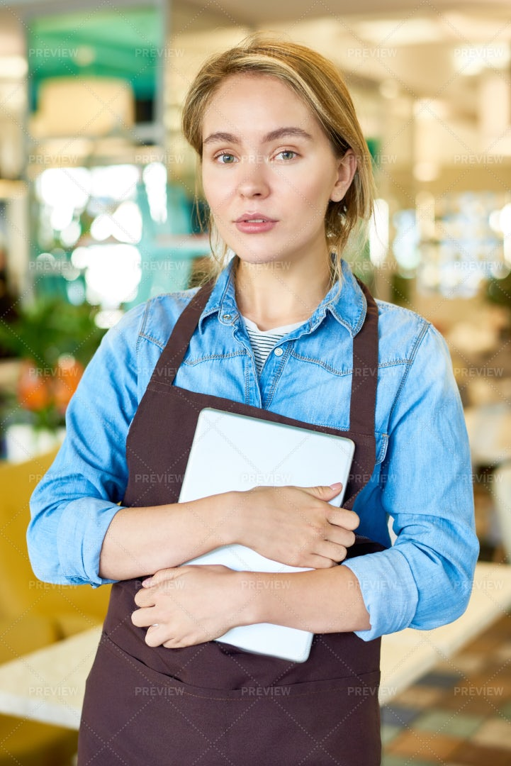 Teenage Waitress Working In Cafe: Stock Photos