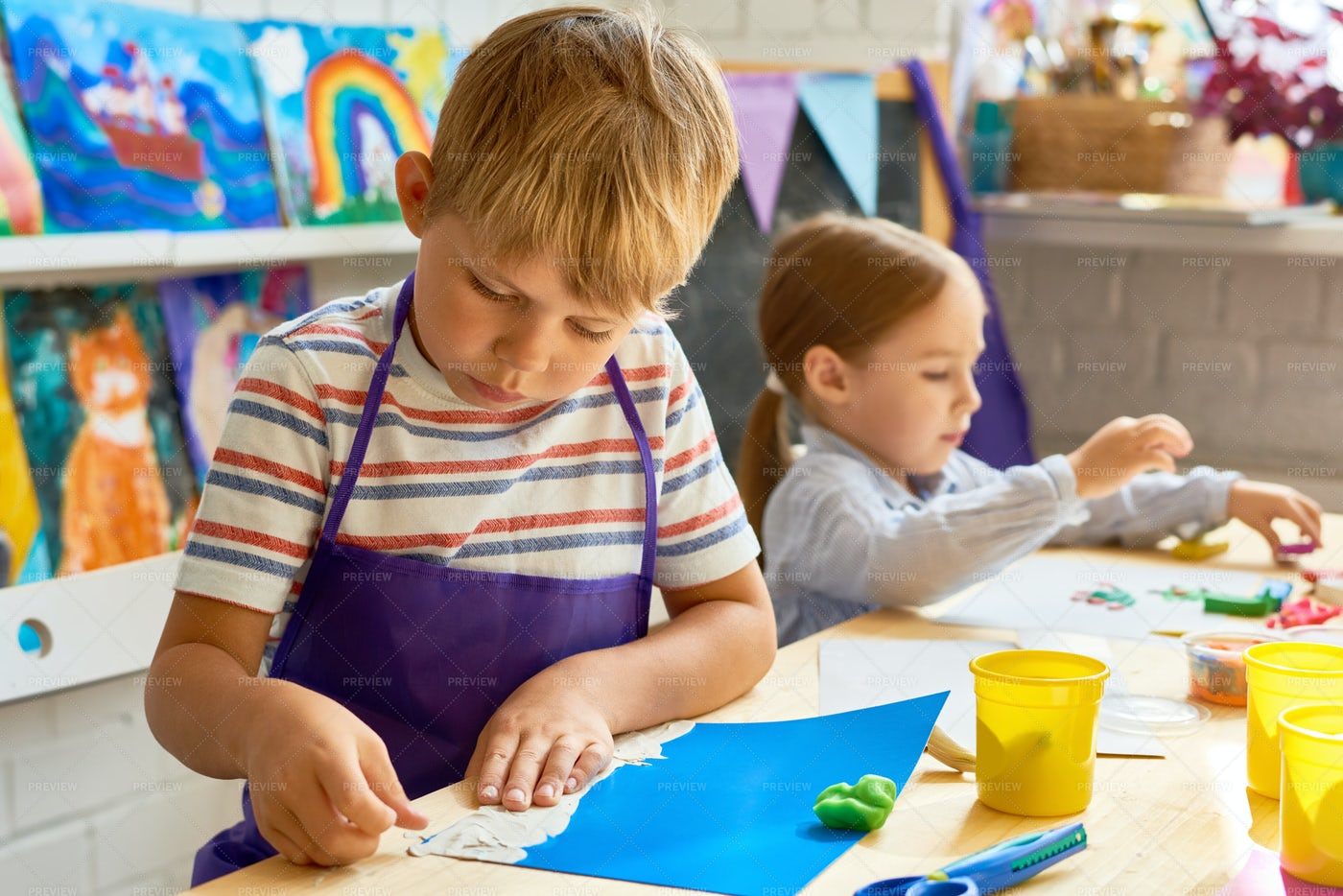 Children Making Plasticine Pictures: Stock Photos