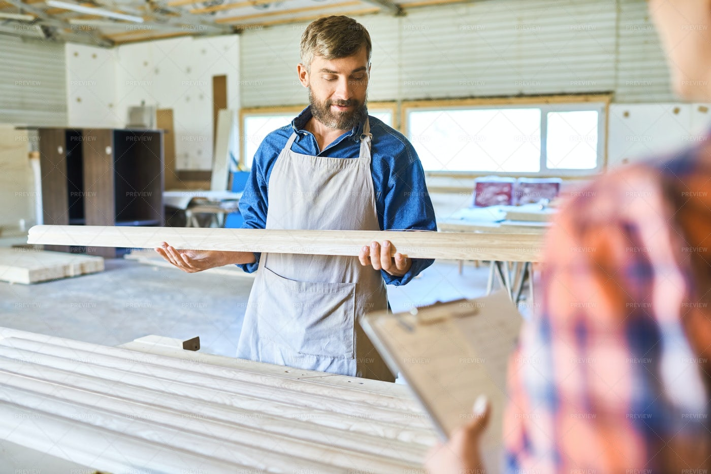 Skilled Carpenter Choosing Wood...: Stock Photos