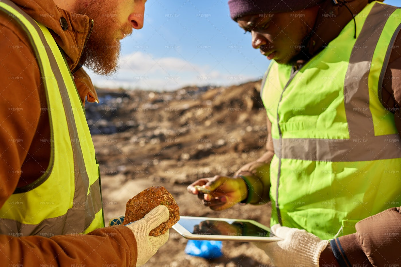 Miners Inspecting Minerals: Stock Photos