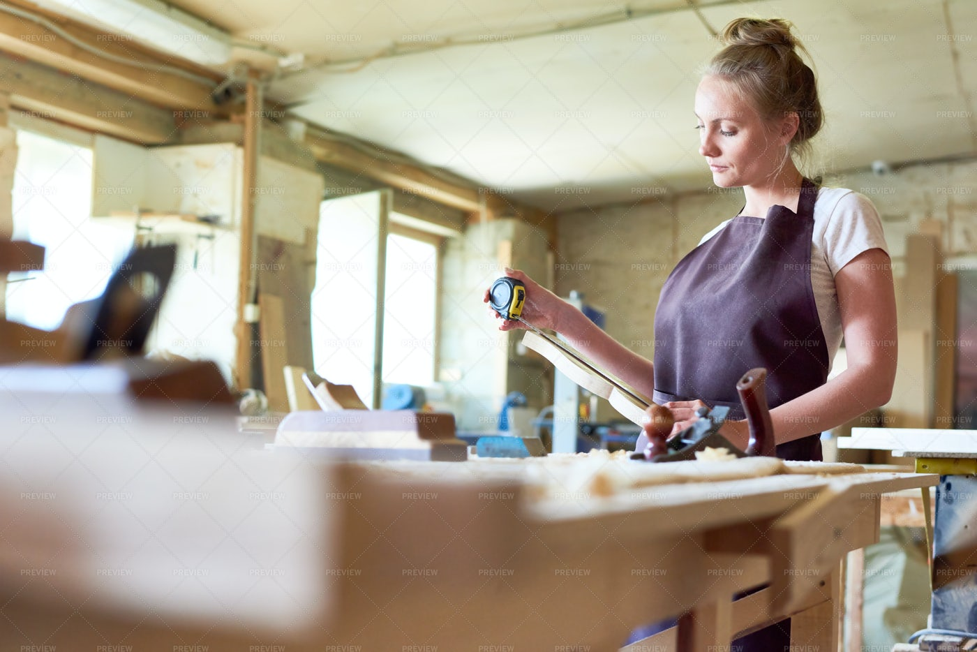 Female Carpenter Working In Shop: Stock Photos