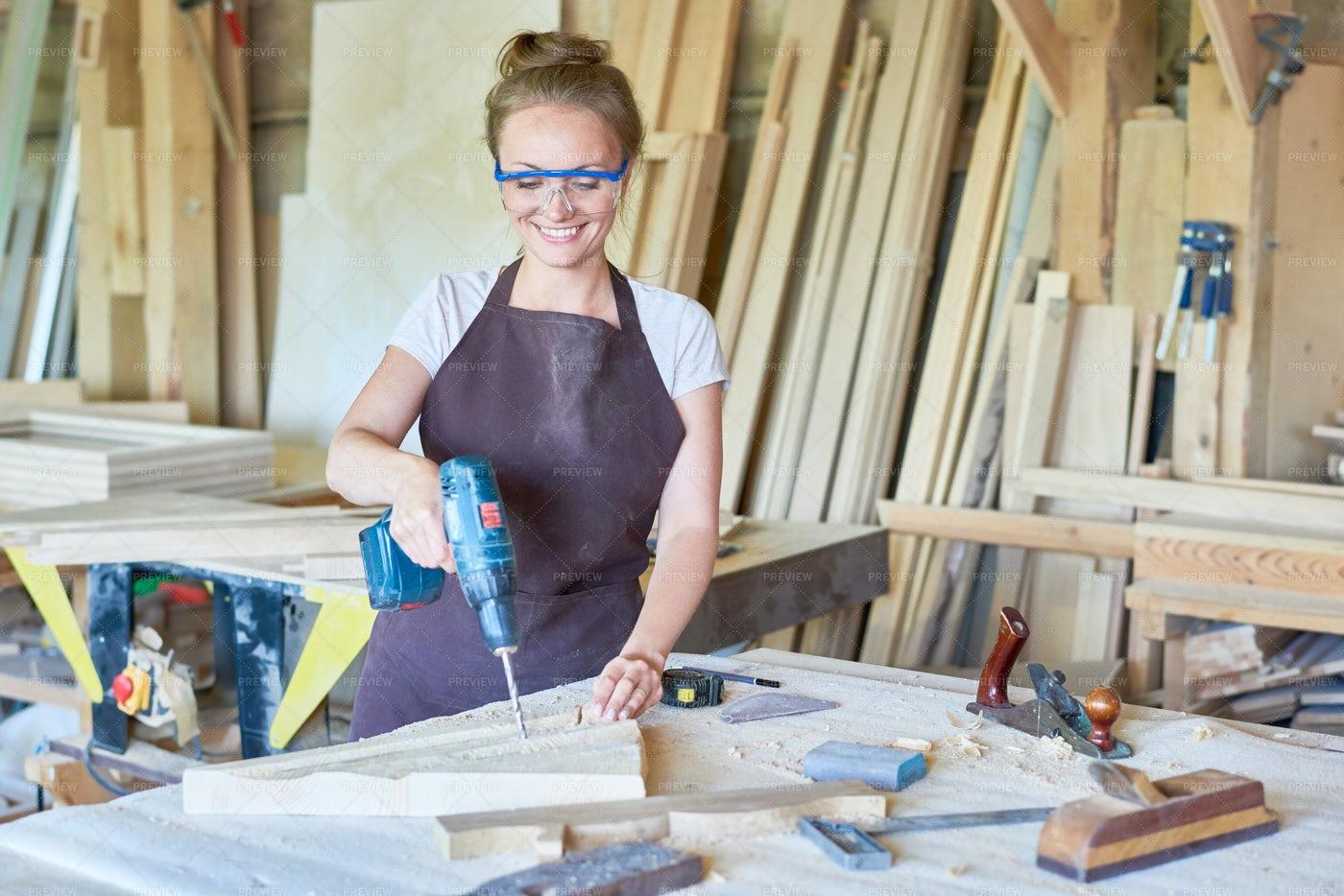 Smiling Female Carpenter Working In...: Stock Photos