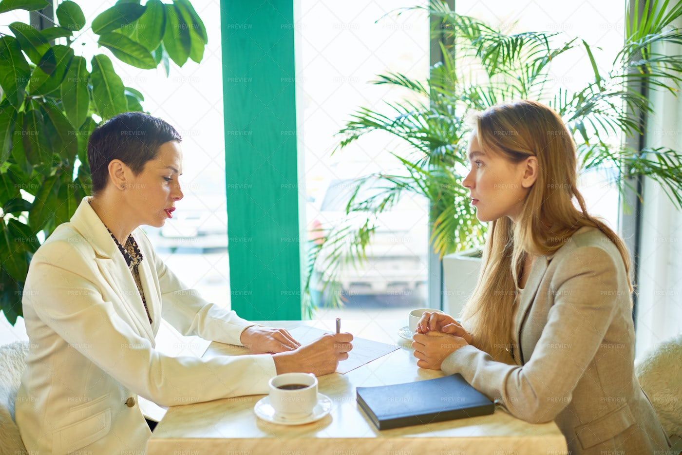 Job Interview Meeting In Cafe: Stock Photos