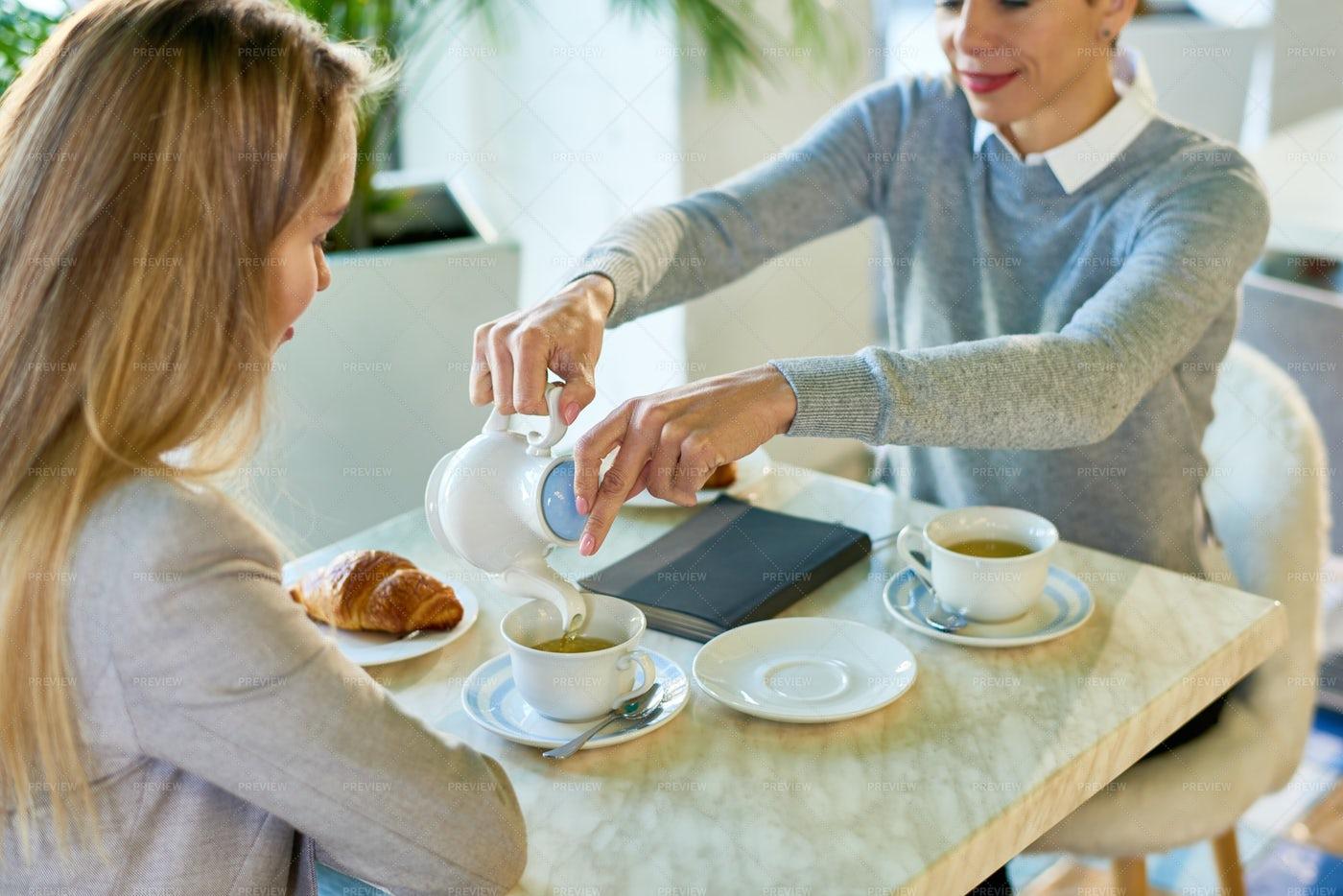 Two Young Women Enjoying Breakfast...: Stock Photos