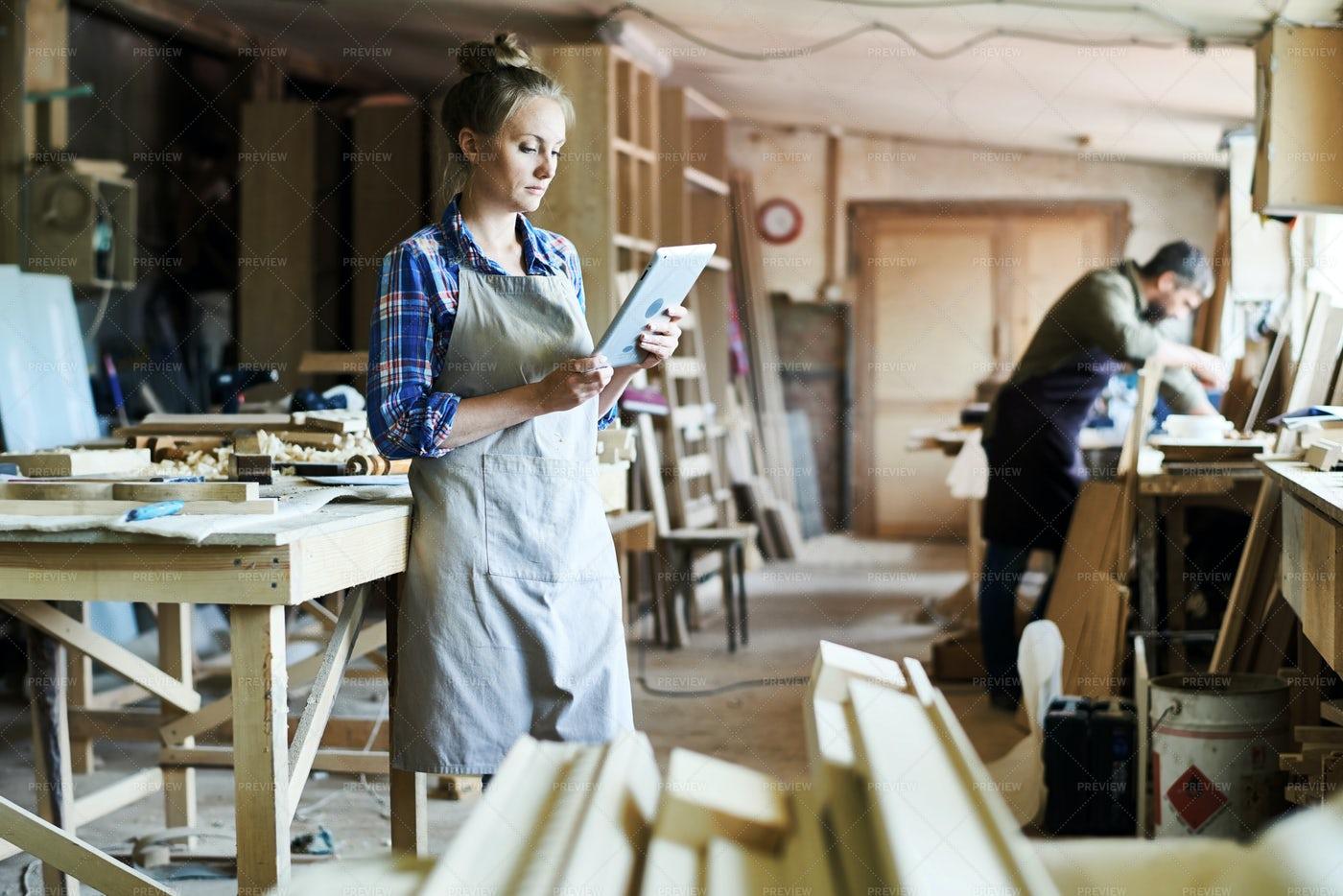 Attractive Craftswoman Using...: Stock Photos