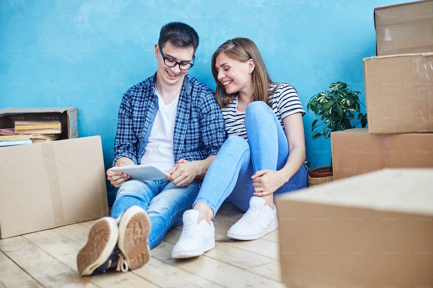 Adorable Couple In New Apartment: Stock Photos