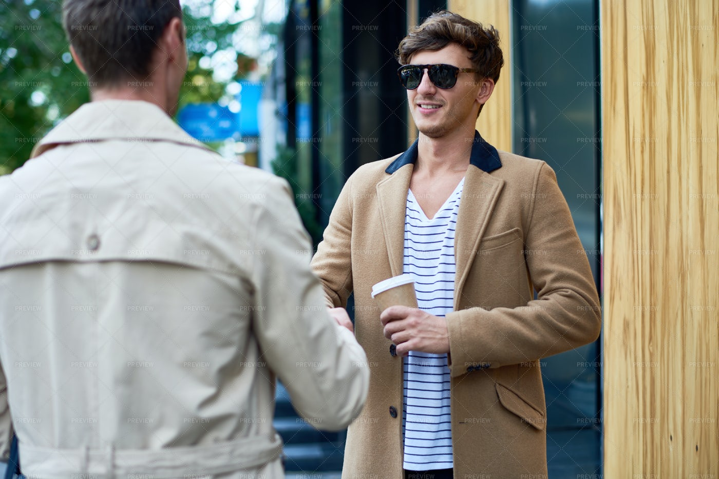 Handsome Young Man Greeting Friend...: Stock Photos