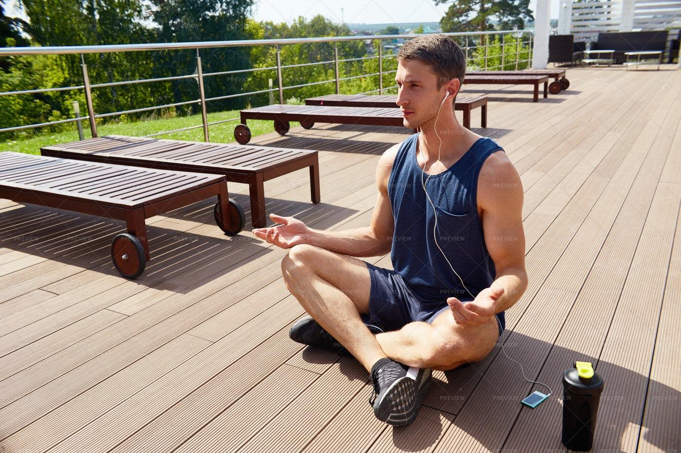 Meditating On Spacious Terrace: Stock Photos