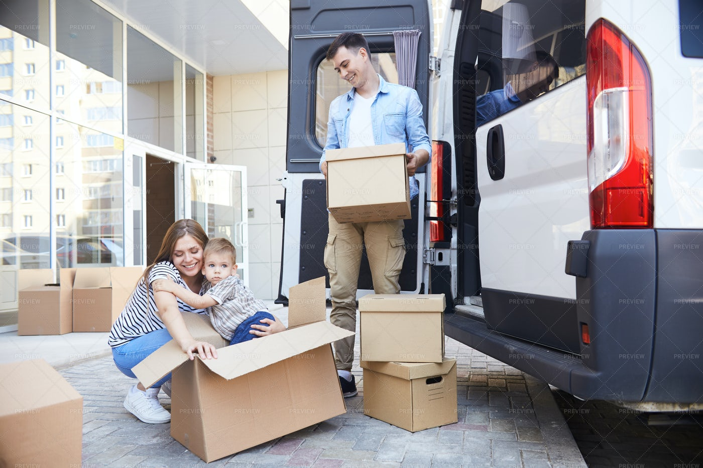 Excited Young Family Moving House: Stock Photos