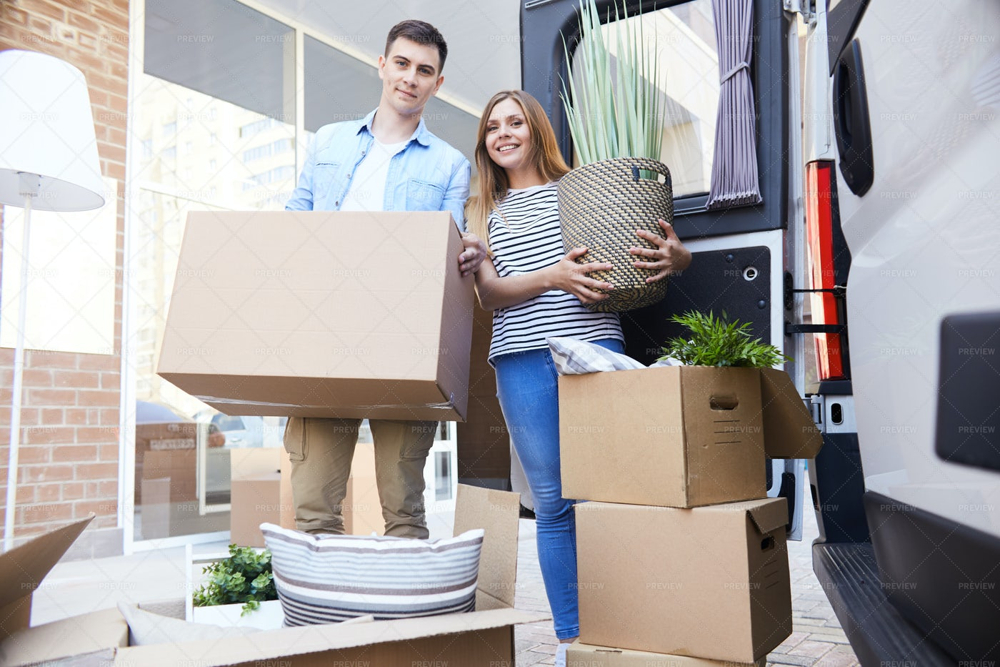 Loving Couple Moving To New Home: Stock Photos