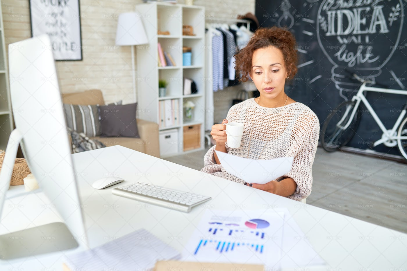 Mixed-Race Woman Working In Modern...: Stock Photos