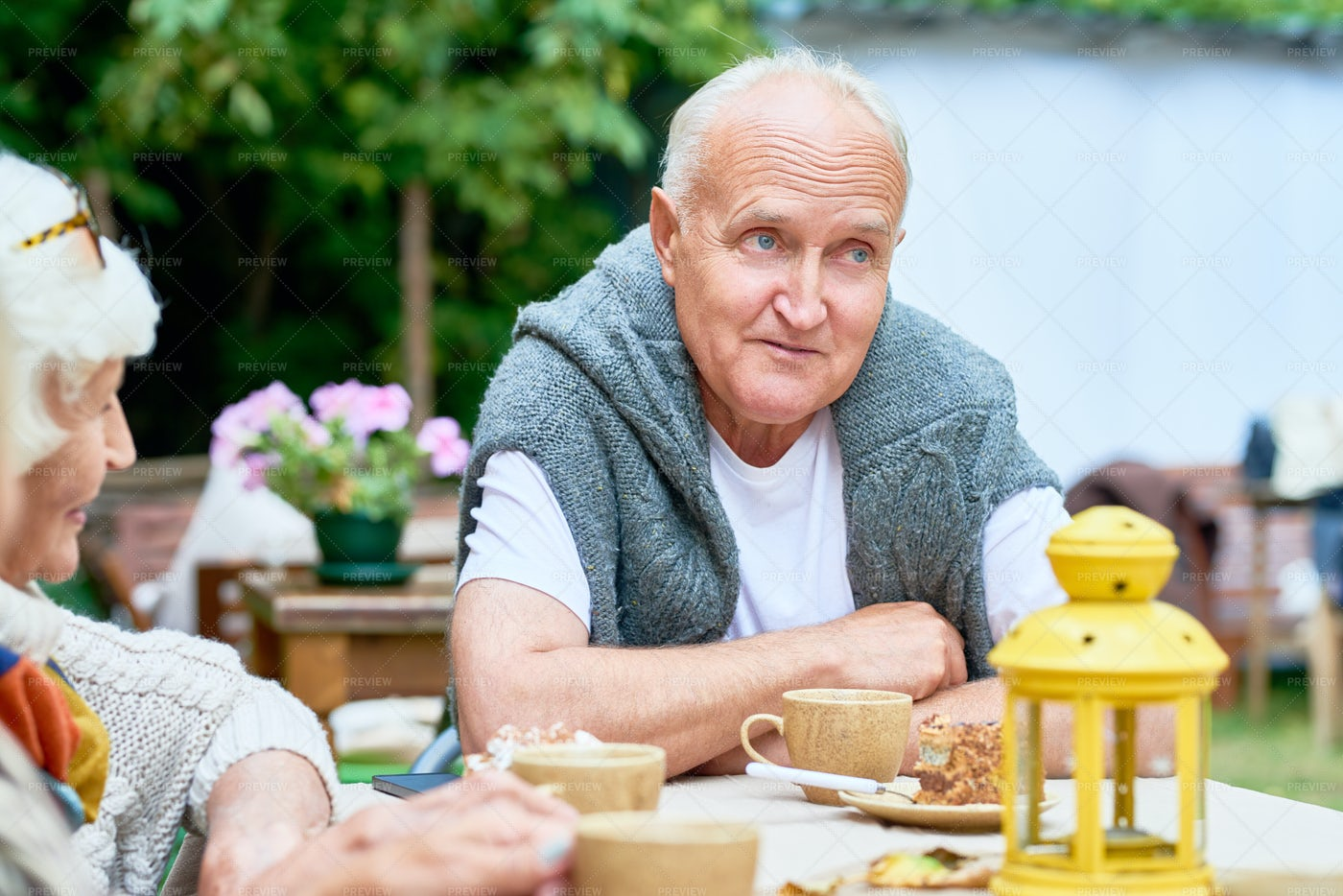 Senior Man Surrounded By Friends: Stock Photos