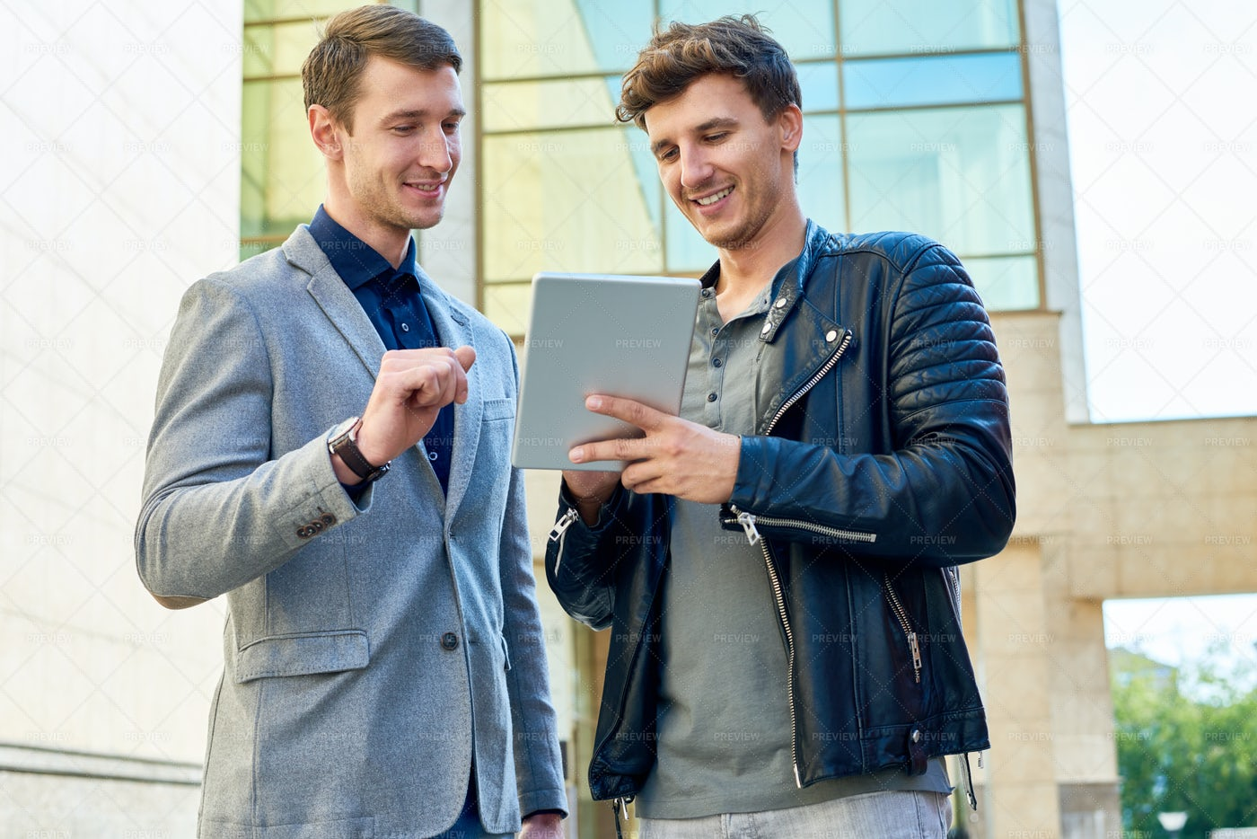 Two  Young Men Using Digital Tablet: Stock Photos