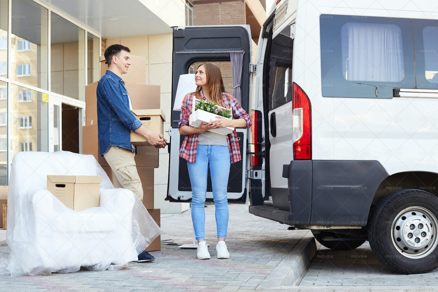 Happy Young Couple Loading Moving...: Stock Photos