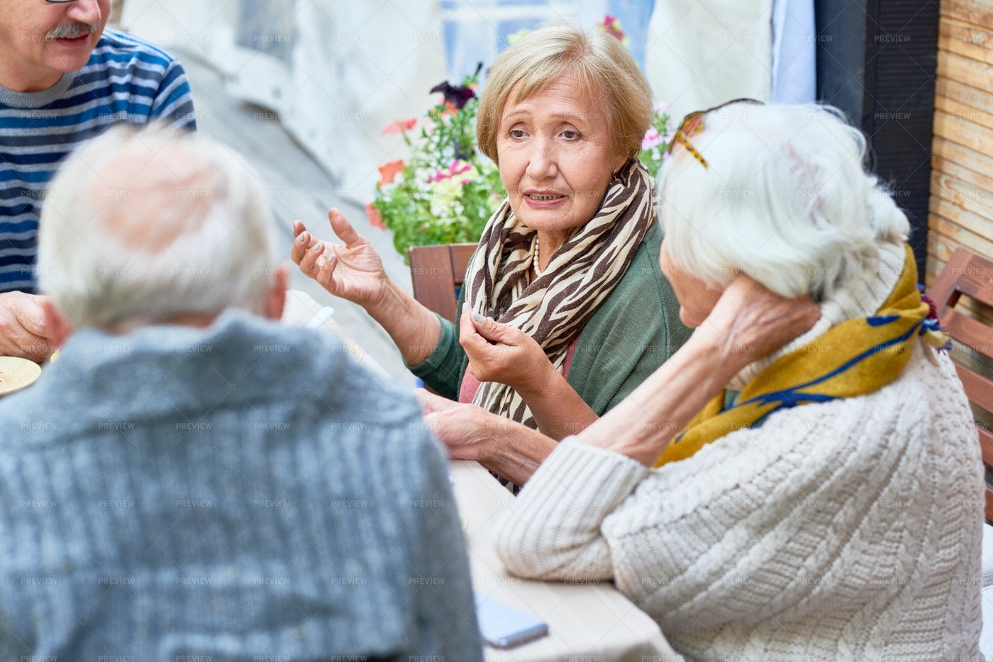 Senior Friends In Cafe Together: Stock Photos