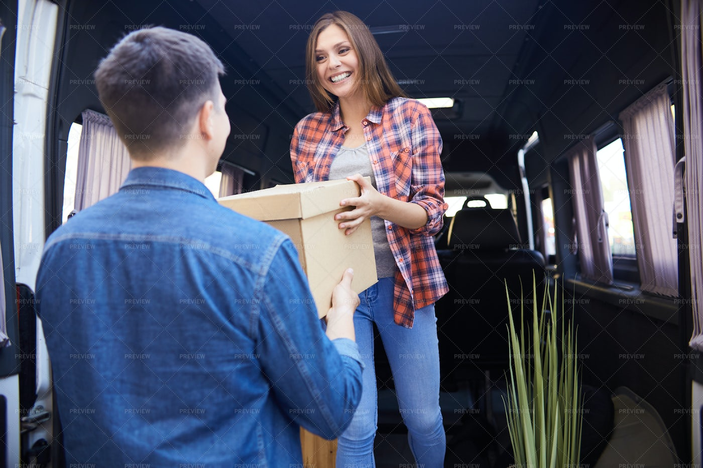 Happy Young Couple Unloading Moving...: Stock Photos