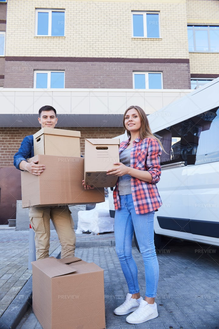 Couple Posing With Boxes Outdoors: Stock Photos