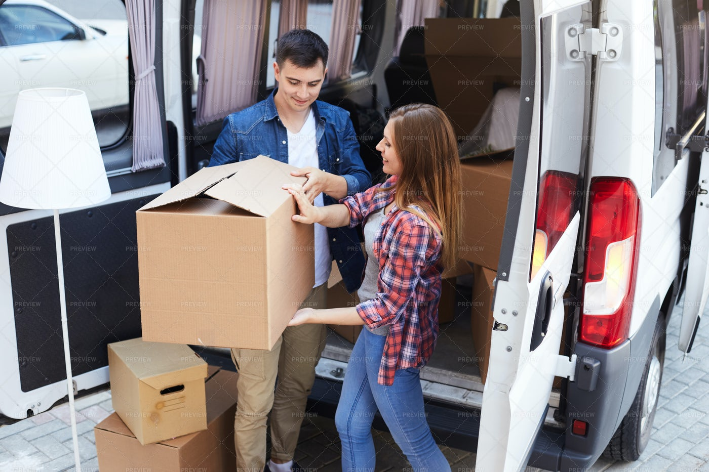 Modern Couple Unloading Van: Stock Photos