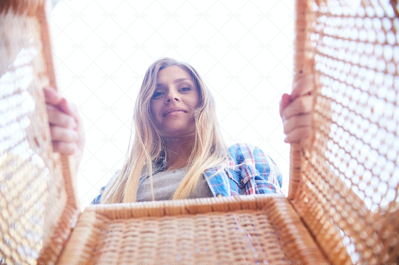 Smiling Woman Holding Basket: Stock Photos