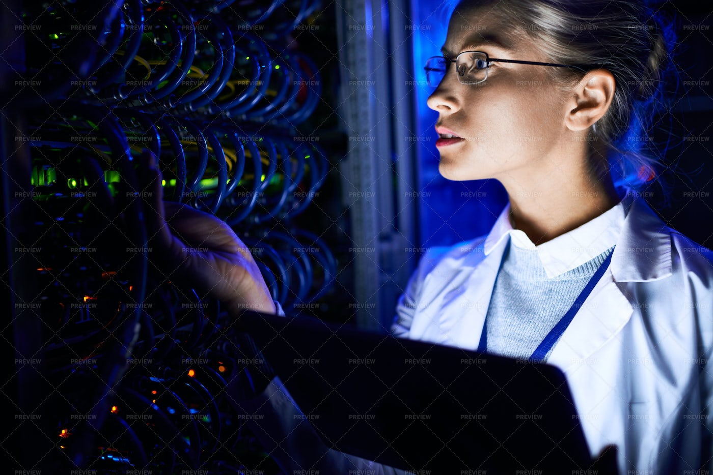 Female Computer Scientist Checking...: Stock Photos