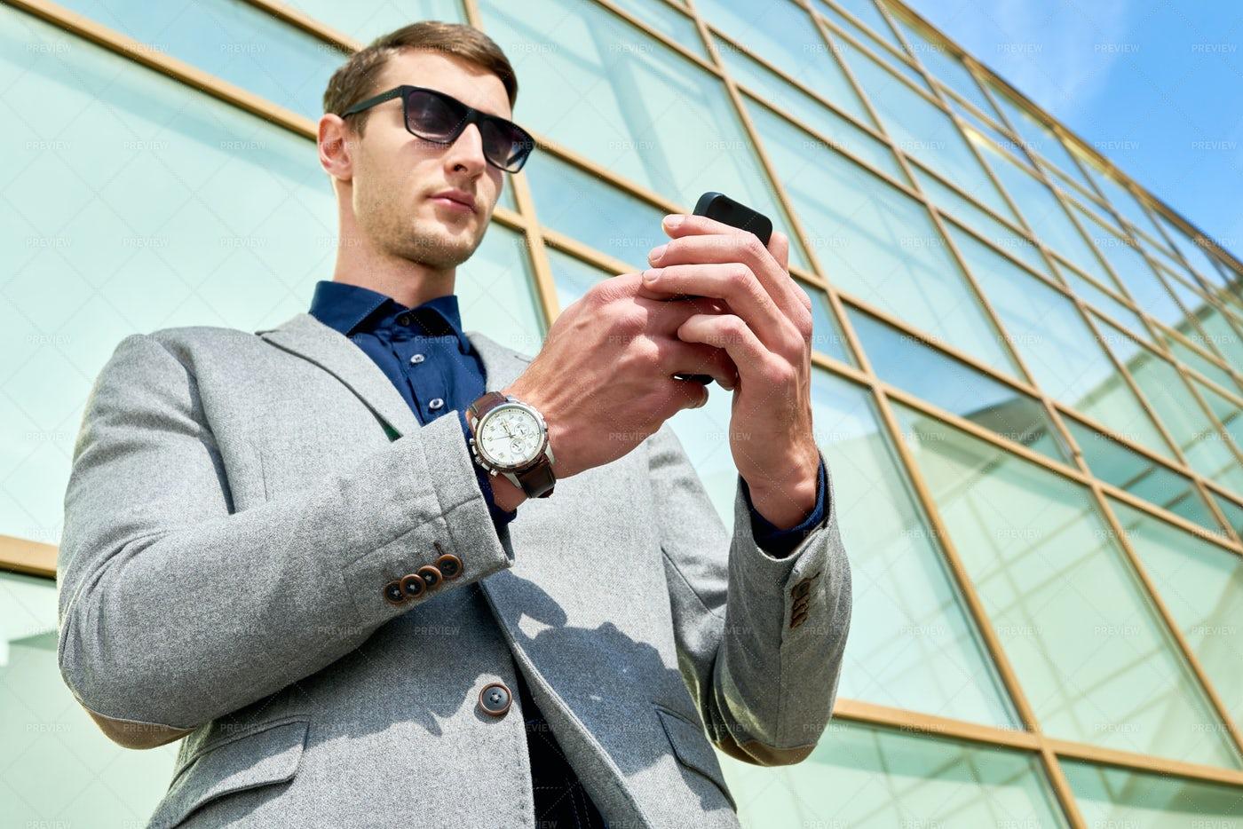 Handsome Businessman Using...: Stock Photos