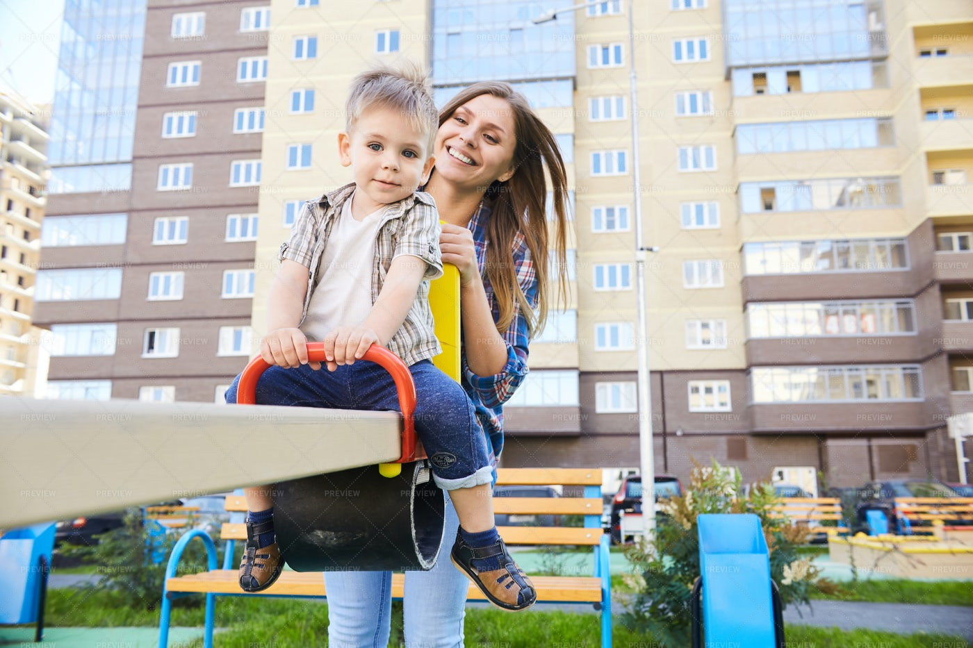 Loving Mother And Son On Playground: Stock Photos