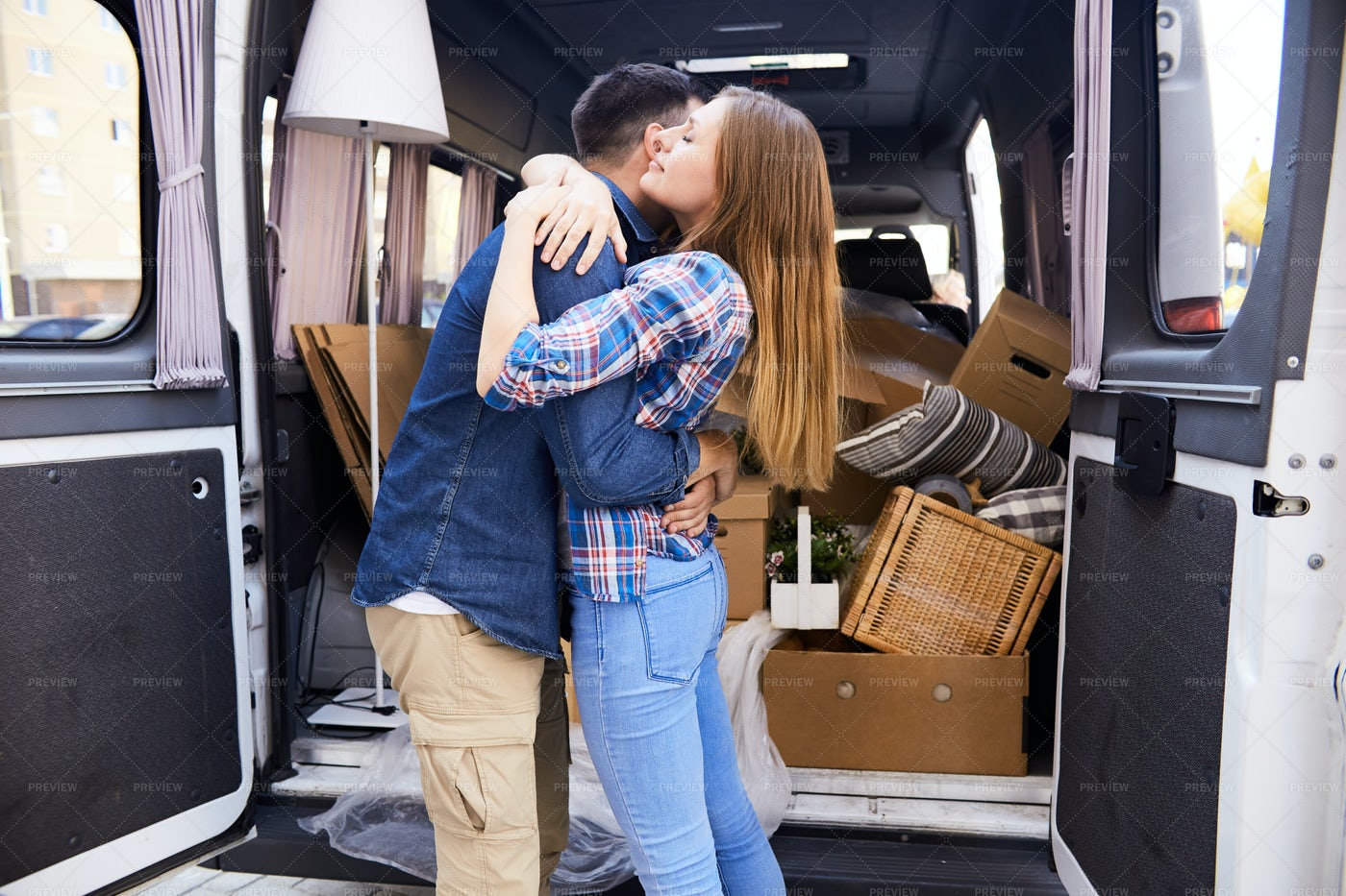 Embracing Couple Moving To New Home: Stock Photos
