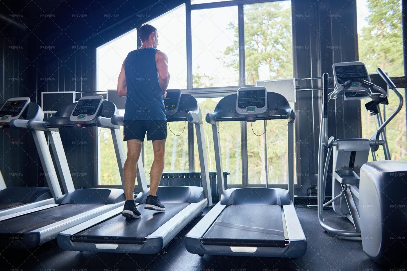 Running On Treadmill At Gym: Stock Photos