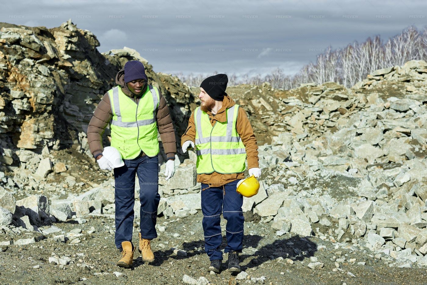Workers Walking On Site In Alaska: Stock Photos
