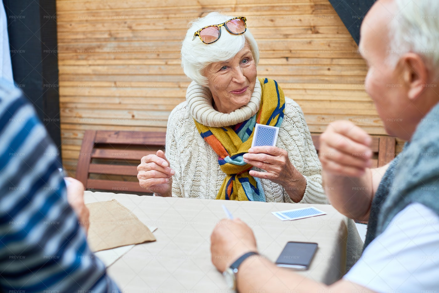 Senior Lady Playing Cards With...: Stock Photos