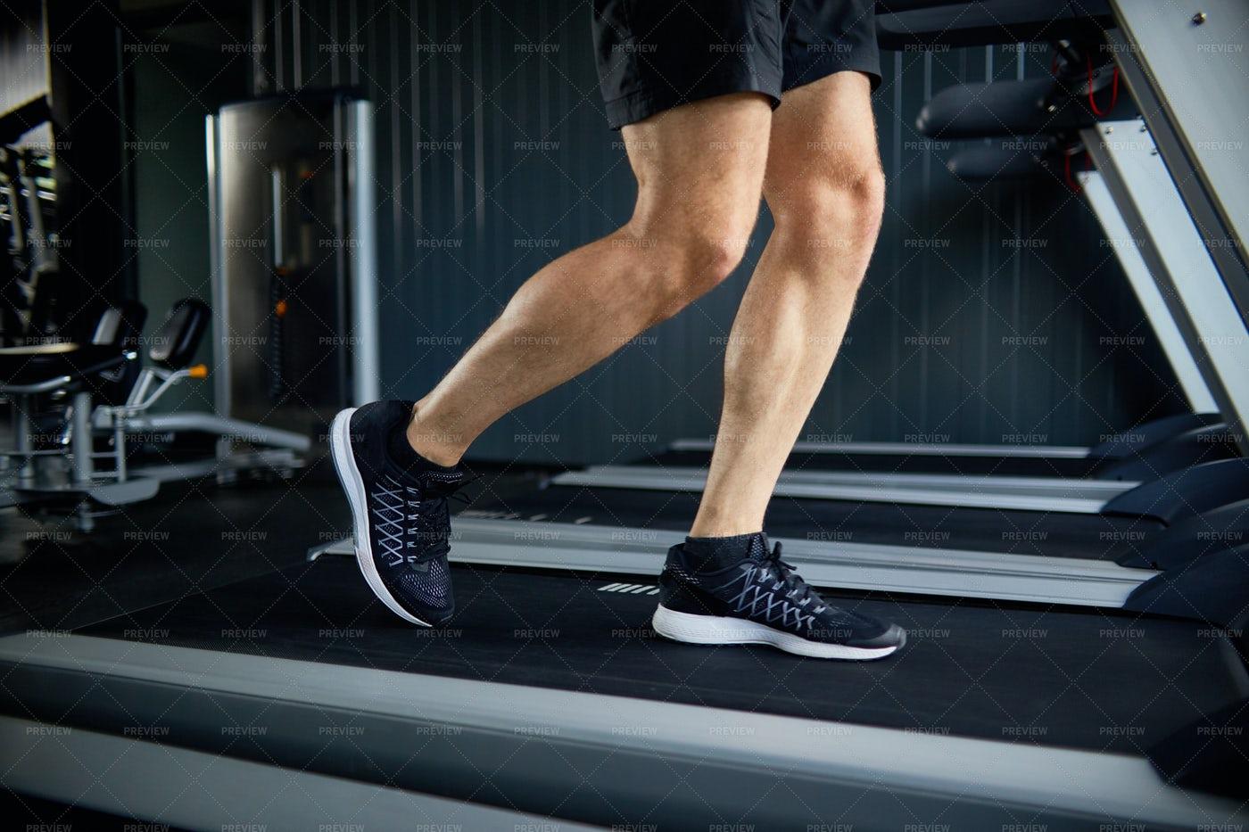 Muscular Legs Running On Treadmill: Stock Photos