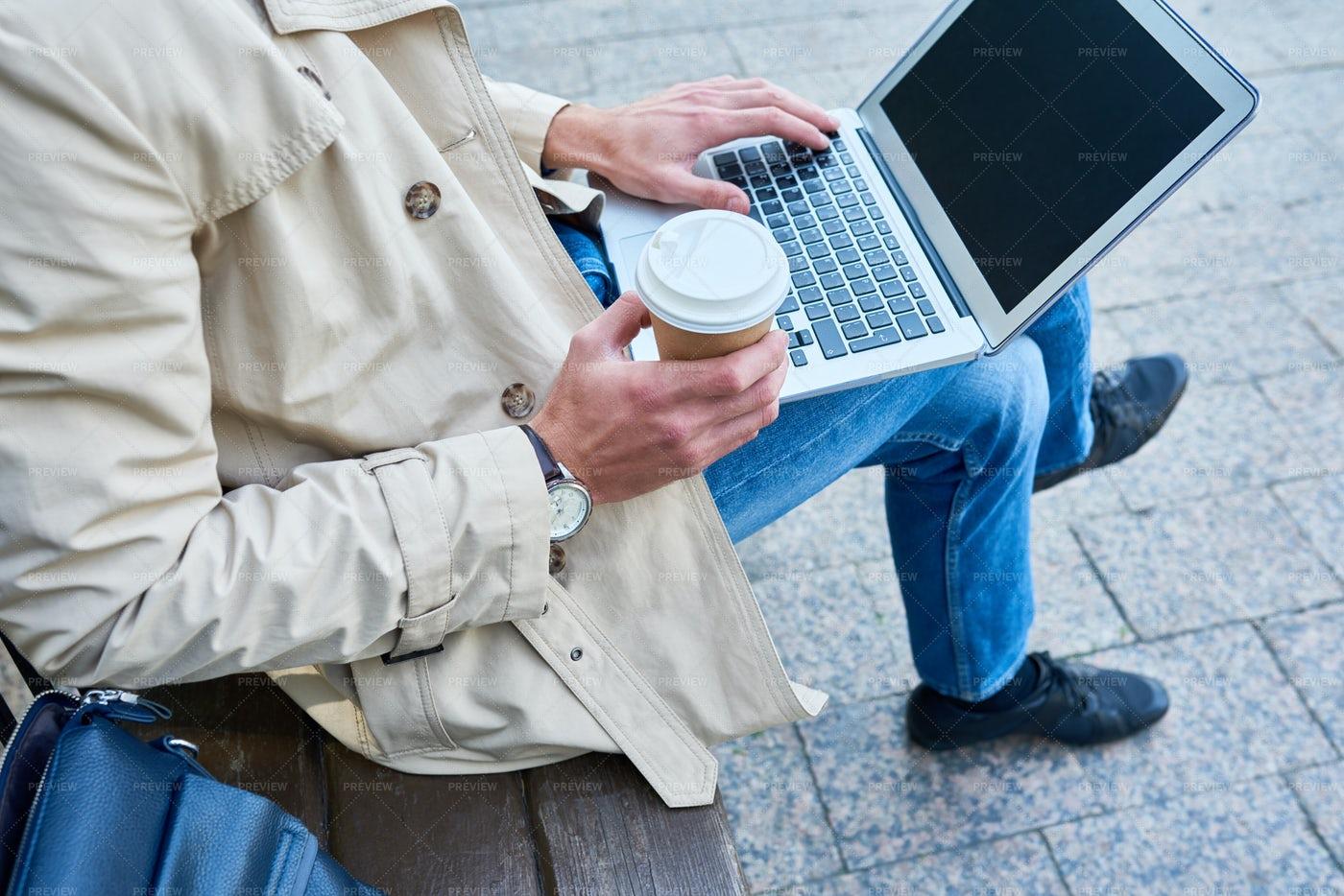 Unrecognizable Man Using Laptop In...: Stock Photos
