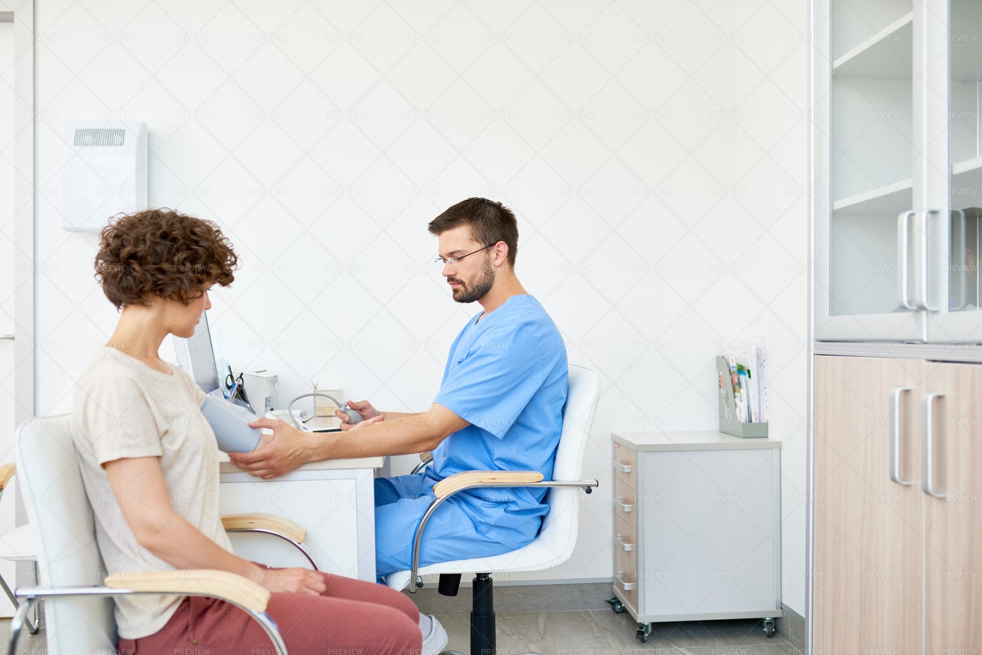 Doctor Measuring Blood Pressure On...: Stock Photos