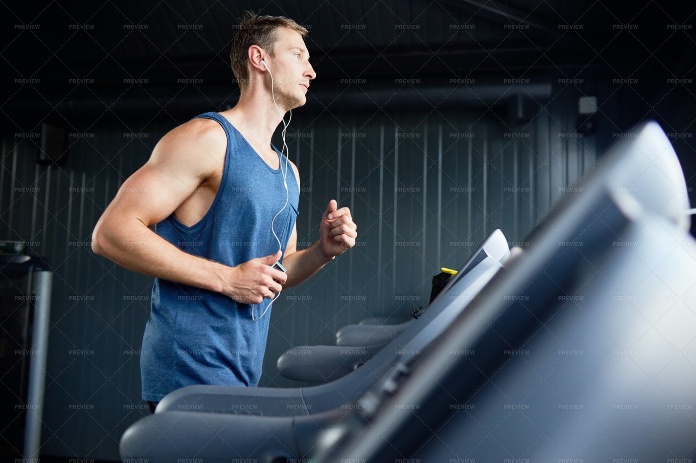 Runner Training In Gym: Stock Photos