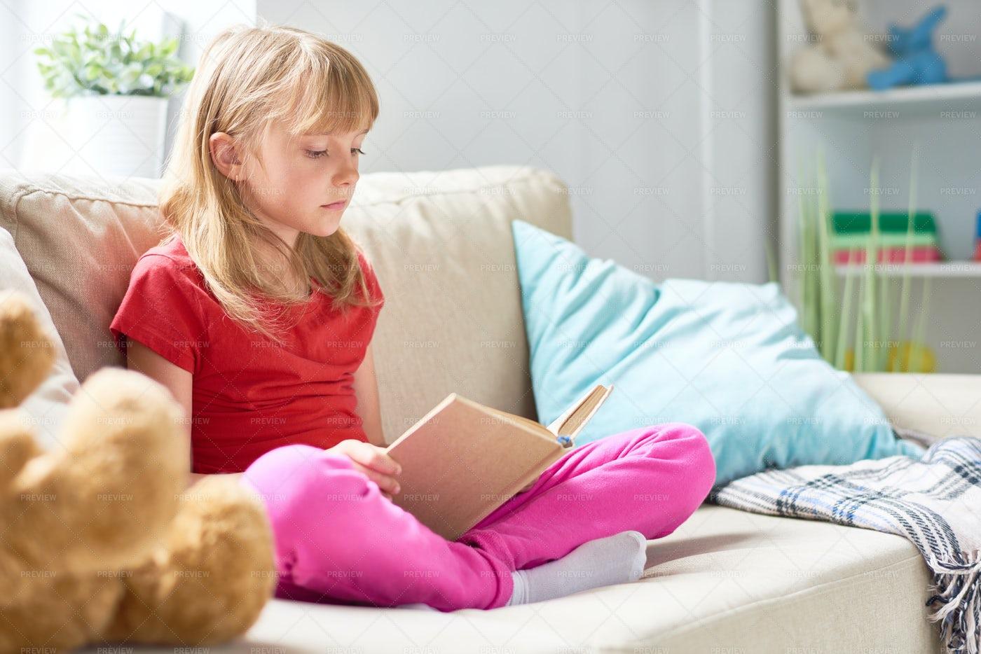Little Girl Reading Book: Stock Photos