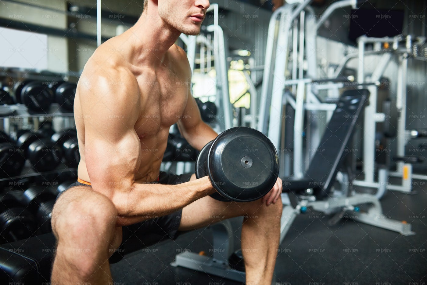 Intensive Training With Dumbbell: Stock Photos