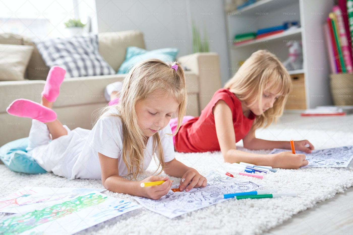 Little Girls Drawing On Floor: Stock Photos
