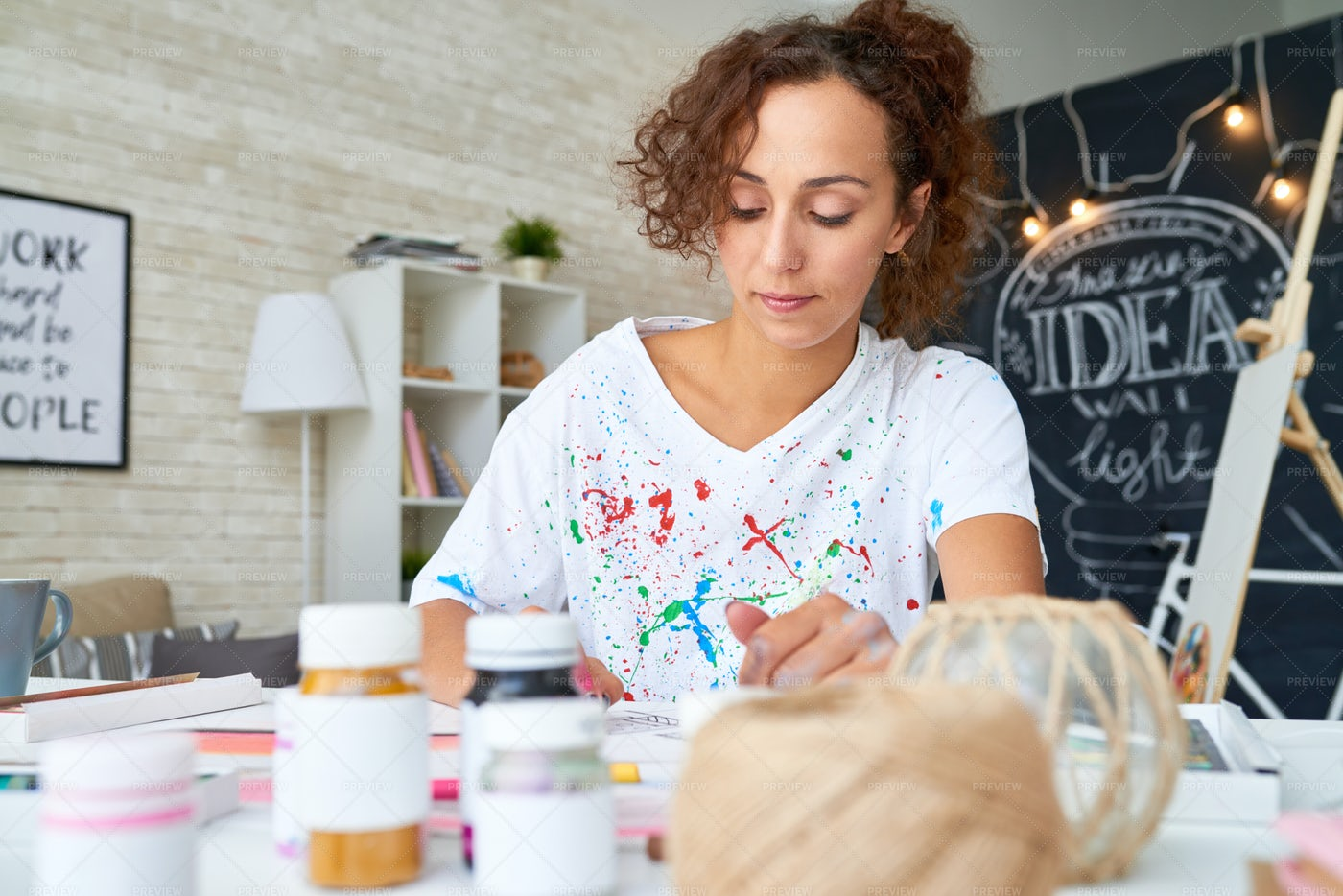 Young Woman Painting Pictures At...: Stock Photos